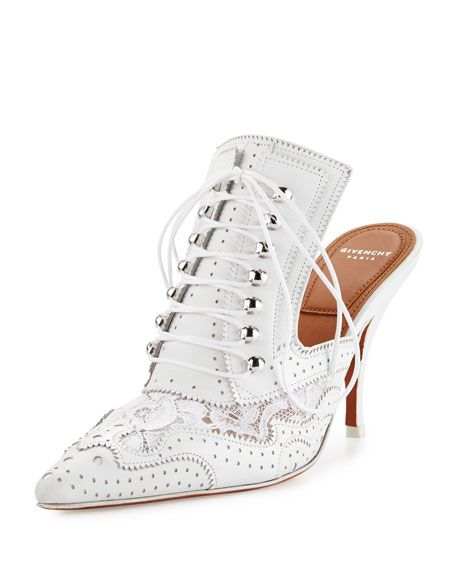 """Givenchy perforated leather and lace mule with pinked trim. 3.5"""" covered heel. Pointed toe. Lace-up front. Slide-on style. Smooth outsole. """"Maremma"""" is made in Italy."""