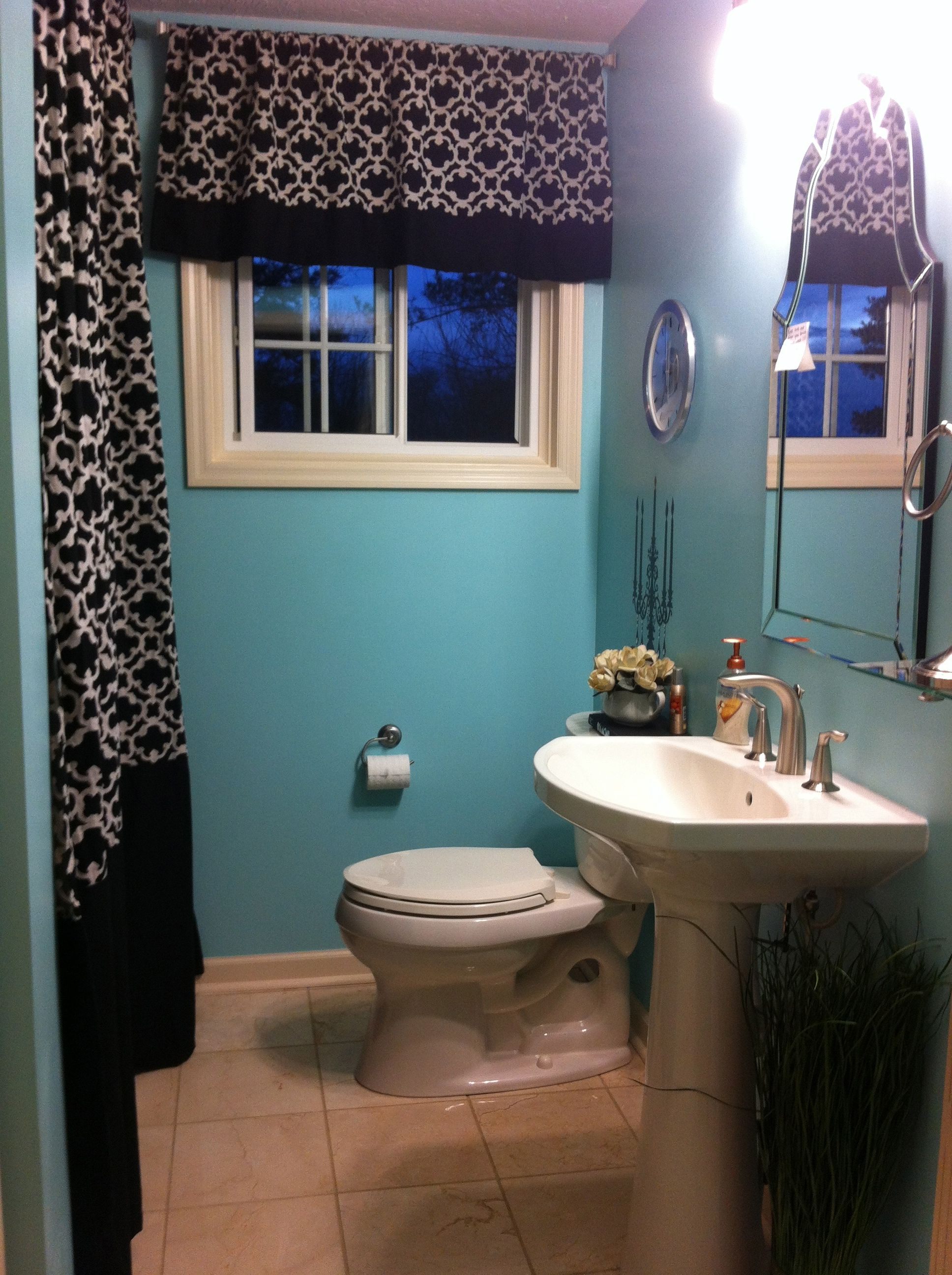 Small bathroom remodel. Shower curtains go from ceiling to floor ...