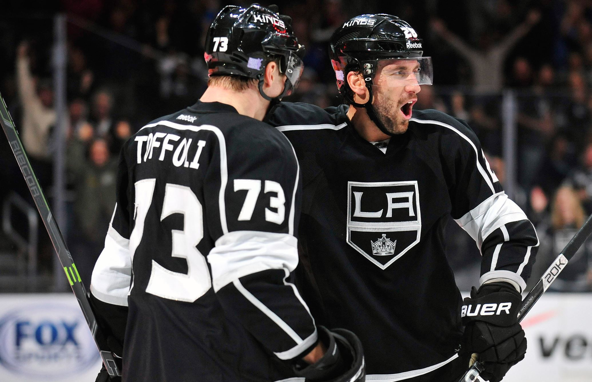 Los Angeles Kings center Tyler Toffoli (73) celebrates with center Jarret Stoll (28) his goal scored... - Gary A. Vasquez/USA TODAY Sports