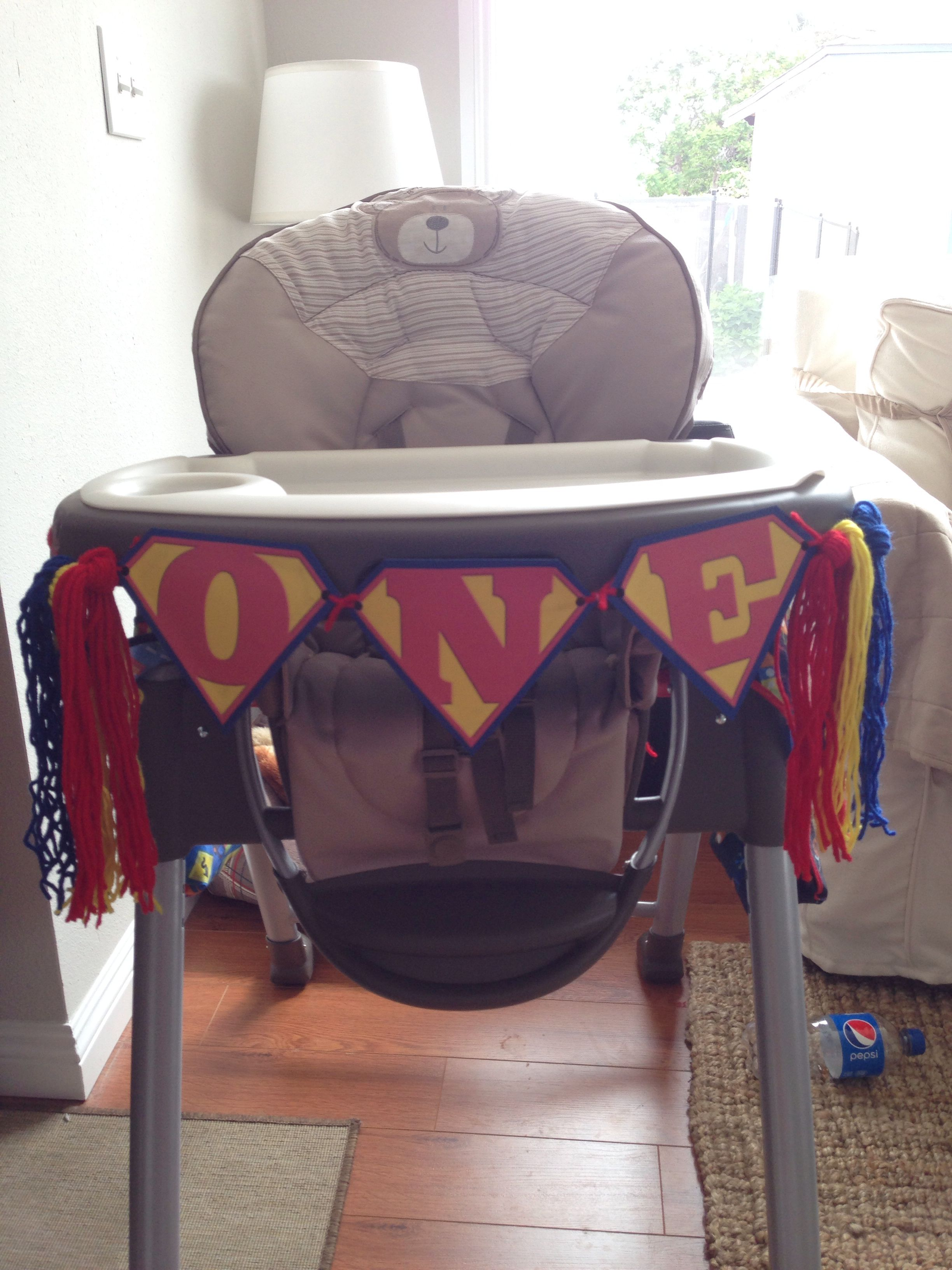 Decorated the Baby's high chair with a banner and Superman theme colored yarn...super cute and easy to do.