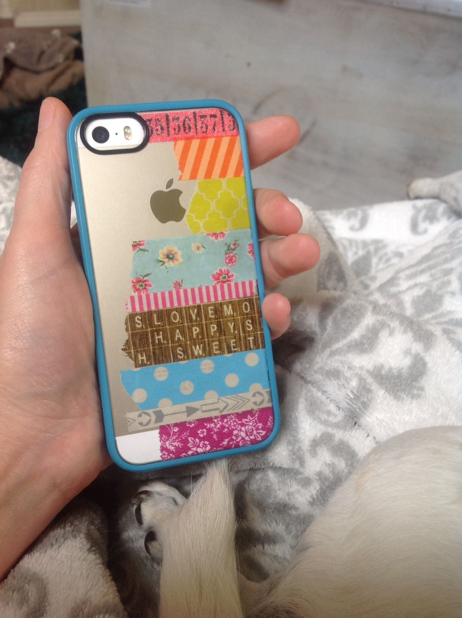 I used a clear back iPhone cover. Cover the back of your phone in the colors/patterns you like, then place your cover over the design. Washi tape will not damage your phone. Change the design whenever you want! Fun!!