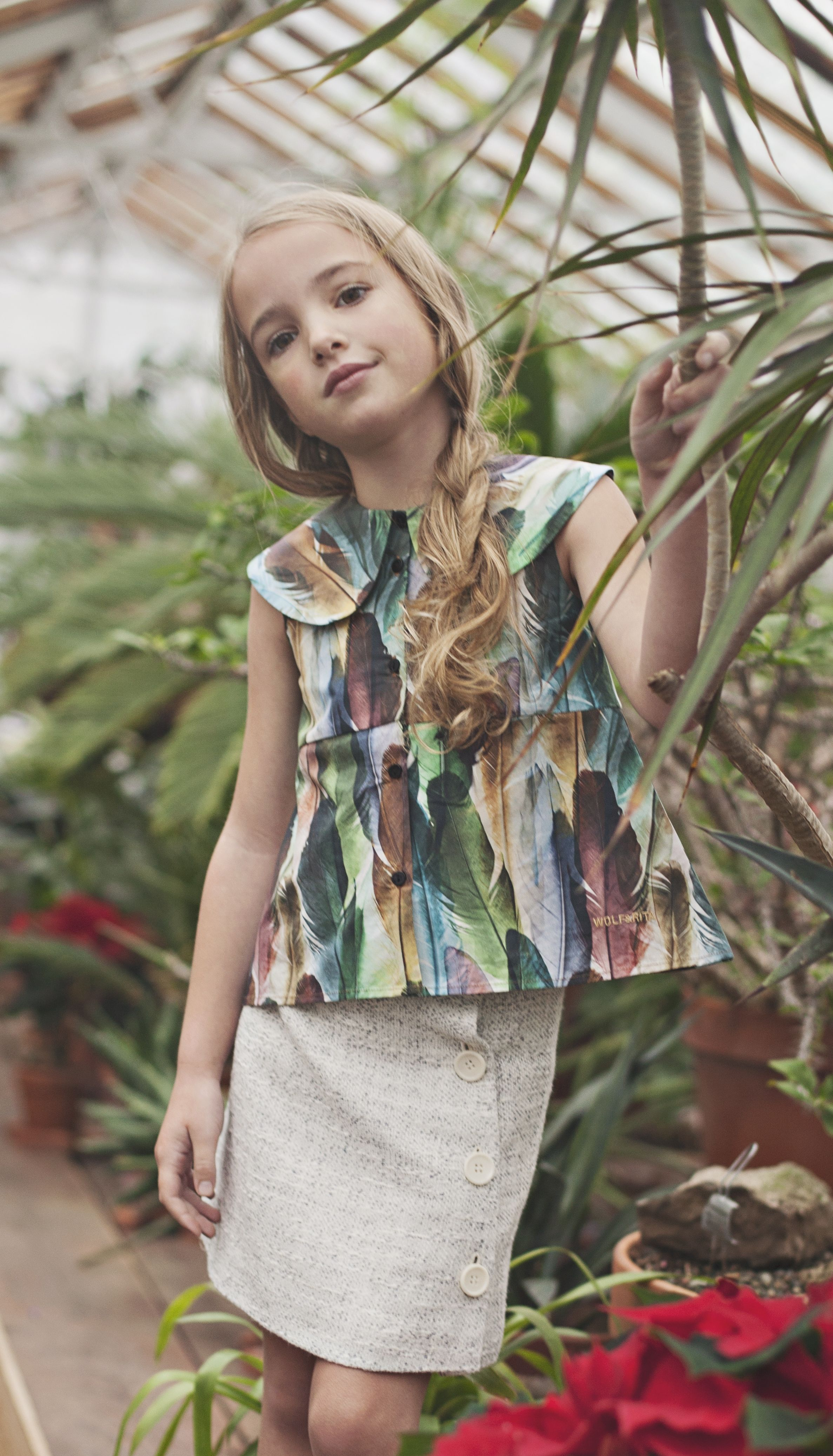 love the feather print on this blouse from Ladida