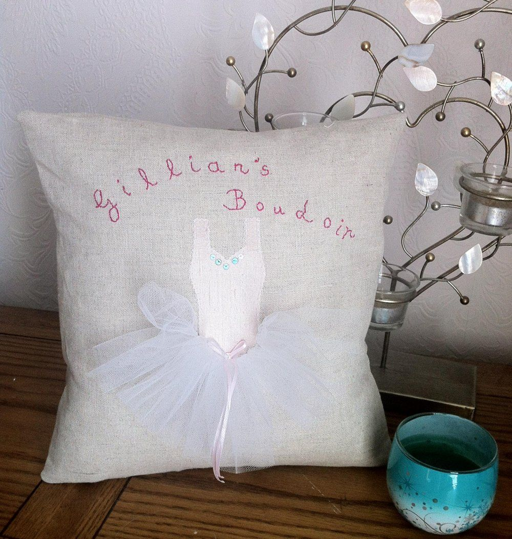 This is a handmade natural beige linen cushion cover with appliqued