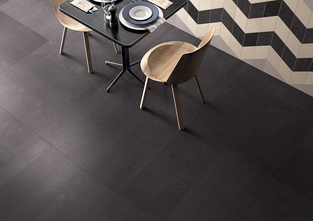 KANVAS #porcelain #stoneware is inspired by the finish of plastered concrete #walls, which clearly show the #signs of the subsequent passages of #paint rollers and brush strokes, mixed with gauze.