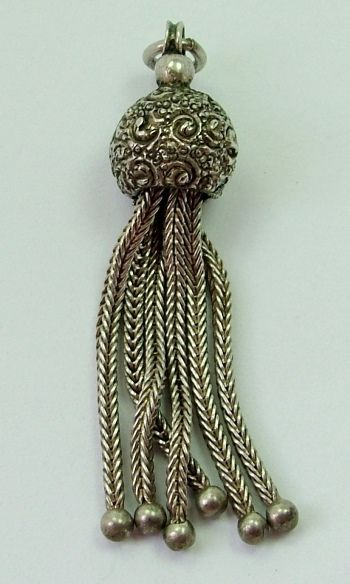 A Victorian c1895 silver tassel fob charm with six tassels, 1.75 inches in length.