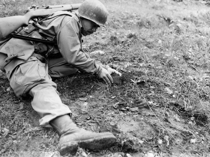 U.S. soldier dug out a German mine World war two, World