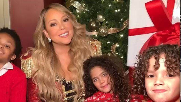 Mariah Carey celebrates as All I want for Christmas hits #1