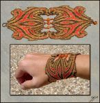 """(2012) 9""""x 3"""", Size 15 seed beads (dark ruby, black, silver-lined orange iris, silver-lined champagne) carnelian beads, polyester thread. I had done this design once before as part of my zodiac ser..."""