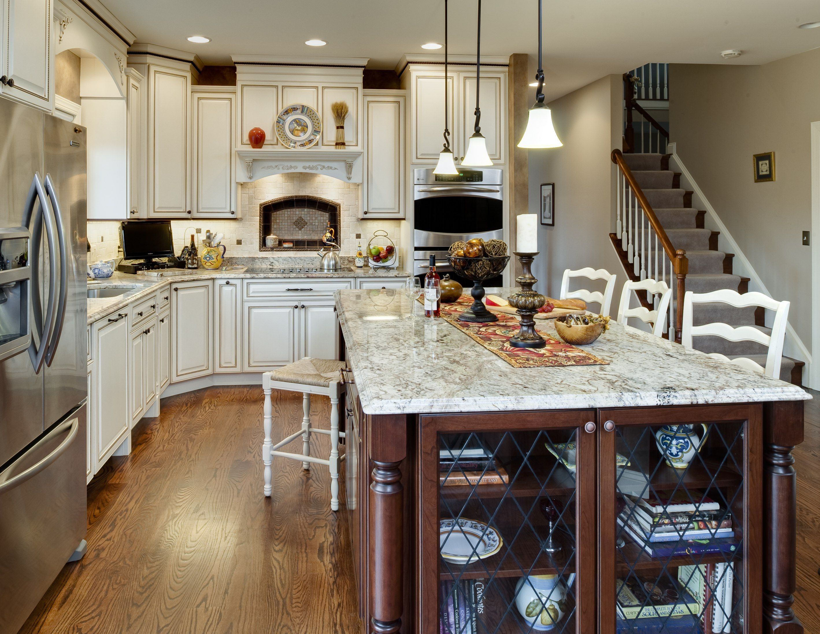 Traditional kitchen wood island off white wall cabinets for Traditional kitchen appliances