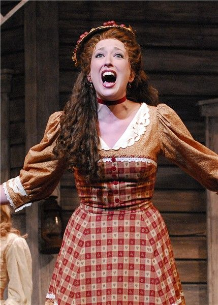 Ado Annie From Oklahoma Love The Orange And The Dress Shape Is Great I Love Her Hair And Hat The Best Sh Oklahoma Musical Musical Hair Broadway Costumes