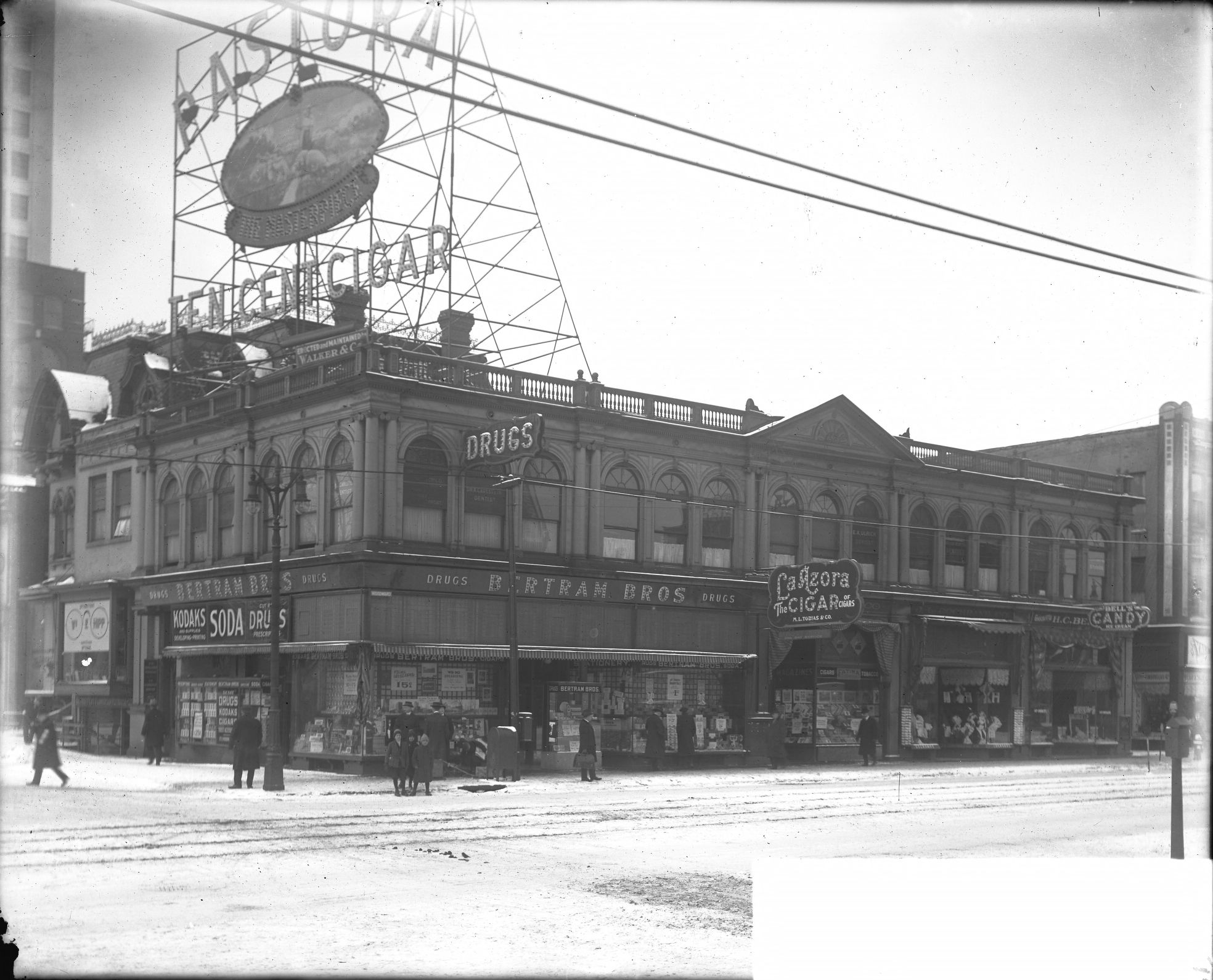 Winter scene of Bertram Bros. Drug Store, located at 2029 Woodward Avenue in Detroit circa 1930
