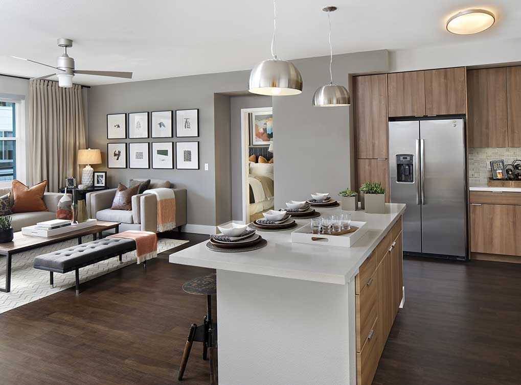 The Kitchen Flows Into The Living Room To Create A Seamless Space Looking For Apartments Apartment Dream House