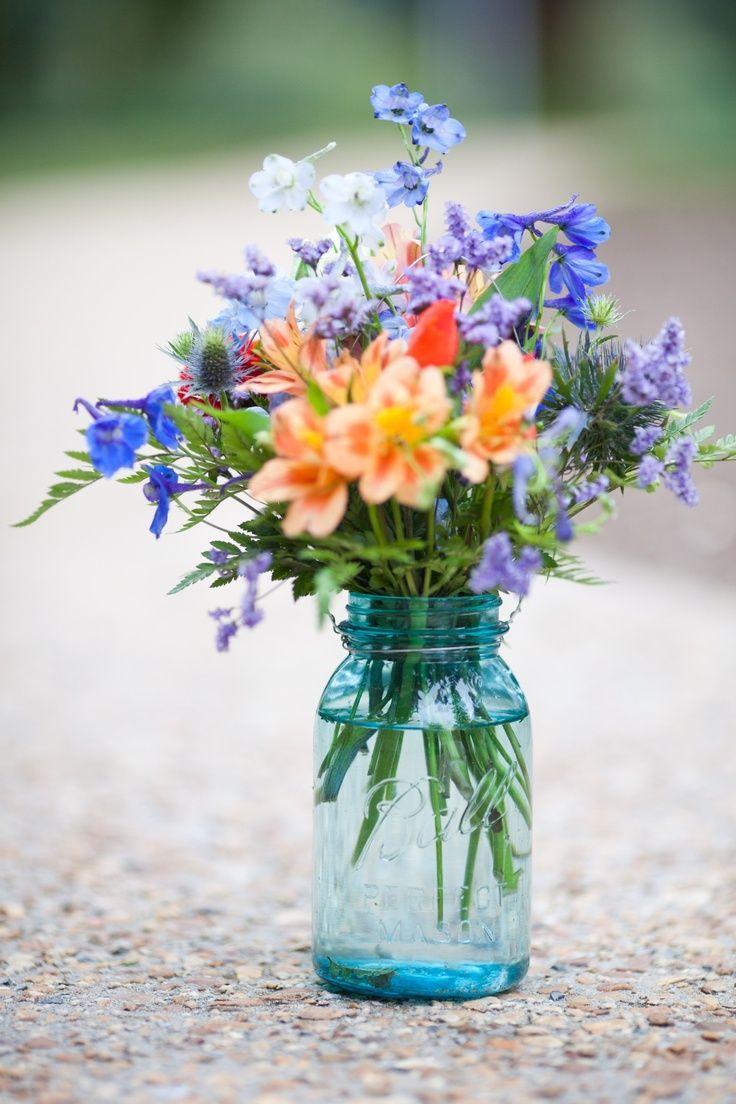 Outdoor wedding flowers mason jars in