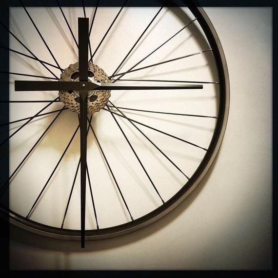 This large wall clock is a real bicycle wheel transformed into a clock, the ultimate steampunk decor and gift for cyclists with a passion for bikes.  This is the industrial clock for every style and decor.*  Every bike wheel clock is between 22