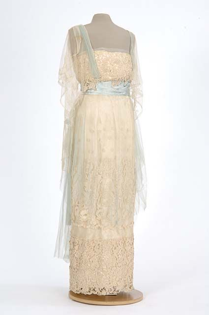 White satin evening gown covered with white lace and pale blue ...