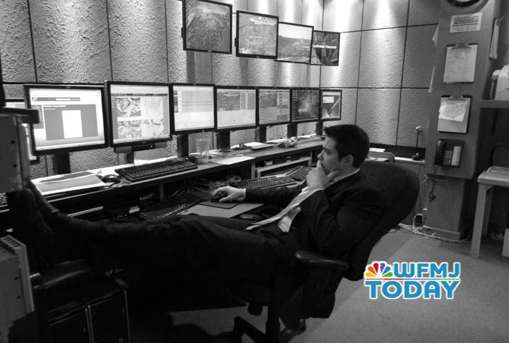 Meteorologist Mark Monstrola in the forecast center in between newscasts.