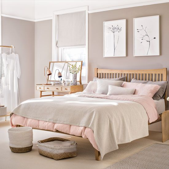 Pale Pink Bedroom With Wooden Furniture And Woven Accessories