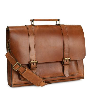 Messenger bag in brown leather with a detachable shoulder strap and handle  at top. Flap with straps and adjustable buckles, one outer compartment  under flap ... 16a3ff249c
