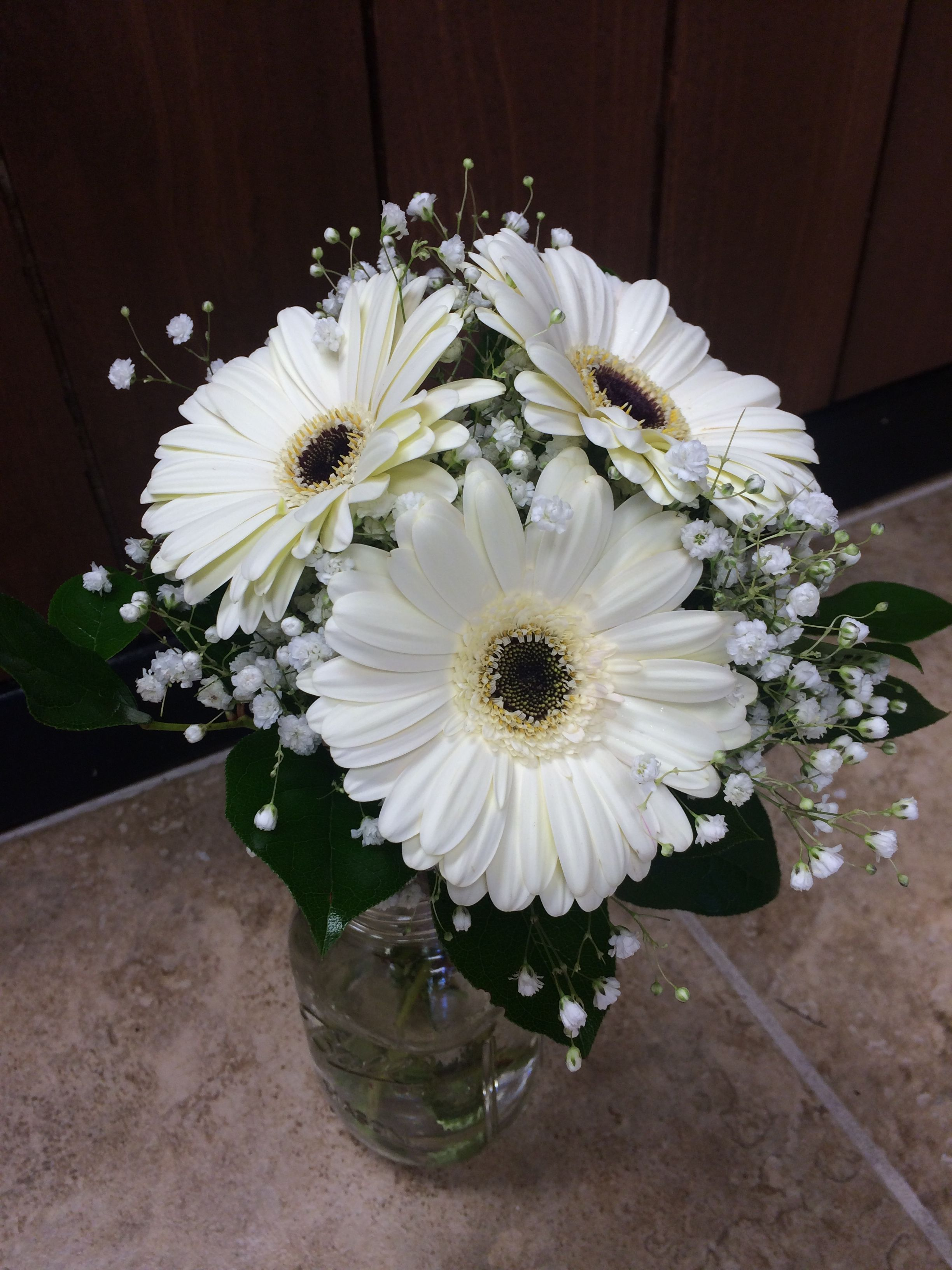 White gerbera daisy bouquet with baby s breath and greens