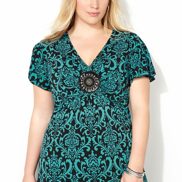 Add a little bling to any outfit with the plus size Scrolling Medallion Sharkbite Top available online at avenue.com. Avenue Store
