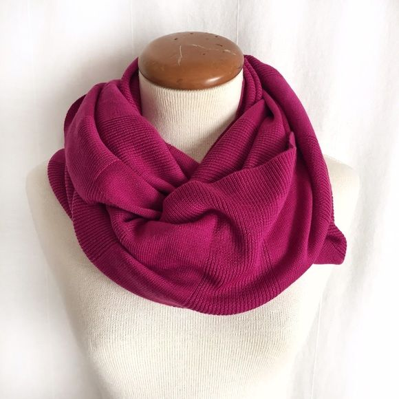 d09e1fac5c2b ... fine-knit scarf in a beautiful dark pink shade that will keep you warm  and bright on a cold day. Alternating textures of solid knit and ribbed-knit .