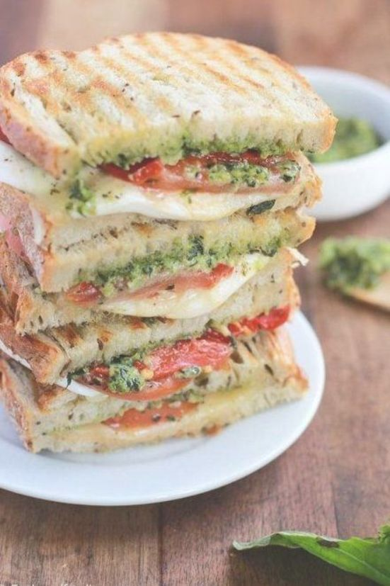 Homemade Grilled Mozzarella Sandwich with Walnut Pesto and Tomato thats easy to assemble and bursting with flavor  lunch never looked so good  Pesto Sandwich  Mozzarella...