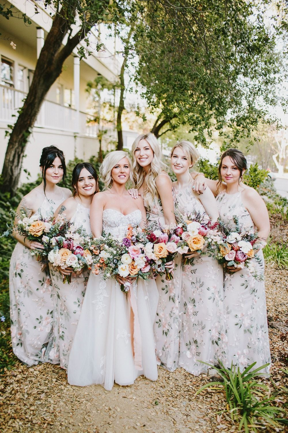 2fbe8d217f8d bridesmaids in floral Jenny Yoo dresses #weddingplanning  #weddinginspiration #bohowedding #floralwedding #weddingideas #weddingday  #bridesmaids