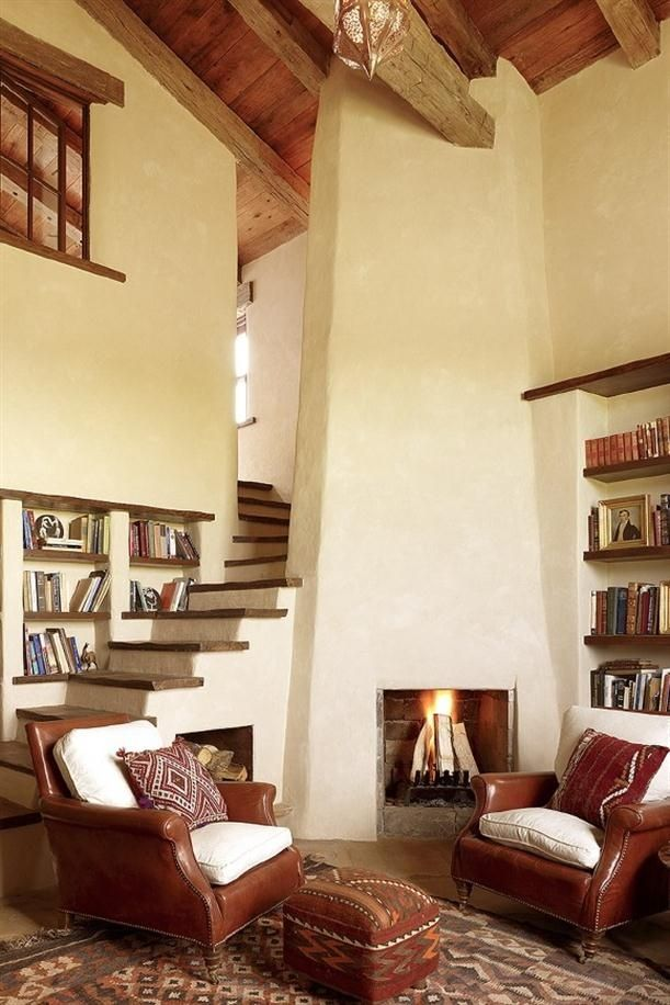 Adobe walls and reclaimed barnwood stairs is perfect for ...