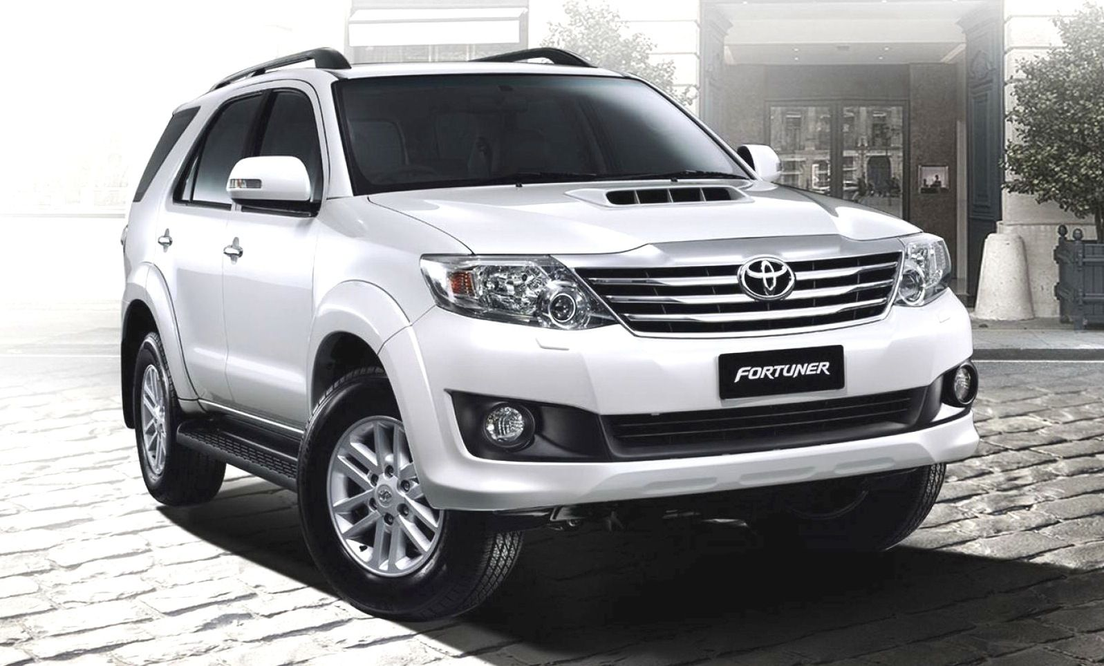 Get Toyota Fortuner Car on Rent in Delhi with english