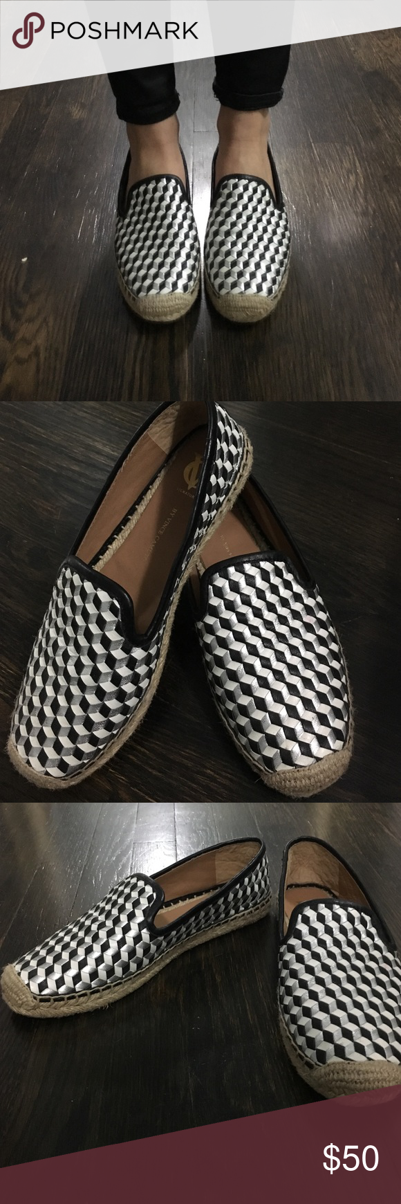 Vince Camuto slip on loafers The leather black, white and silver design makes these loafers super cute and versatile. The sole on the outside of the shoe is a straw-like material. Love these, they just don't fit me right! Never worn outside. Vince Camuto Shoes