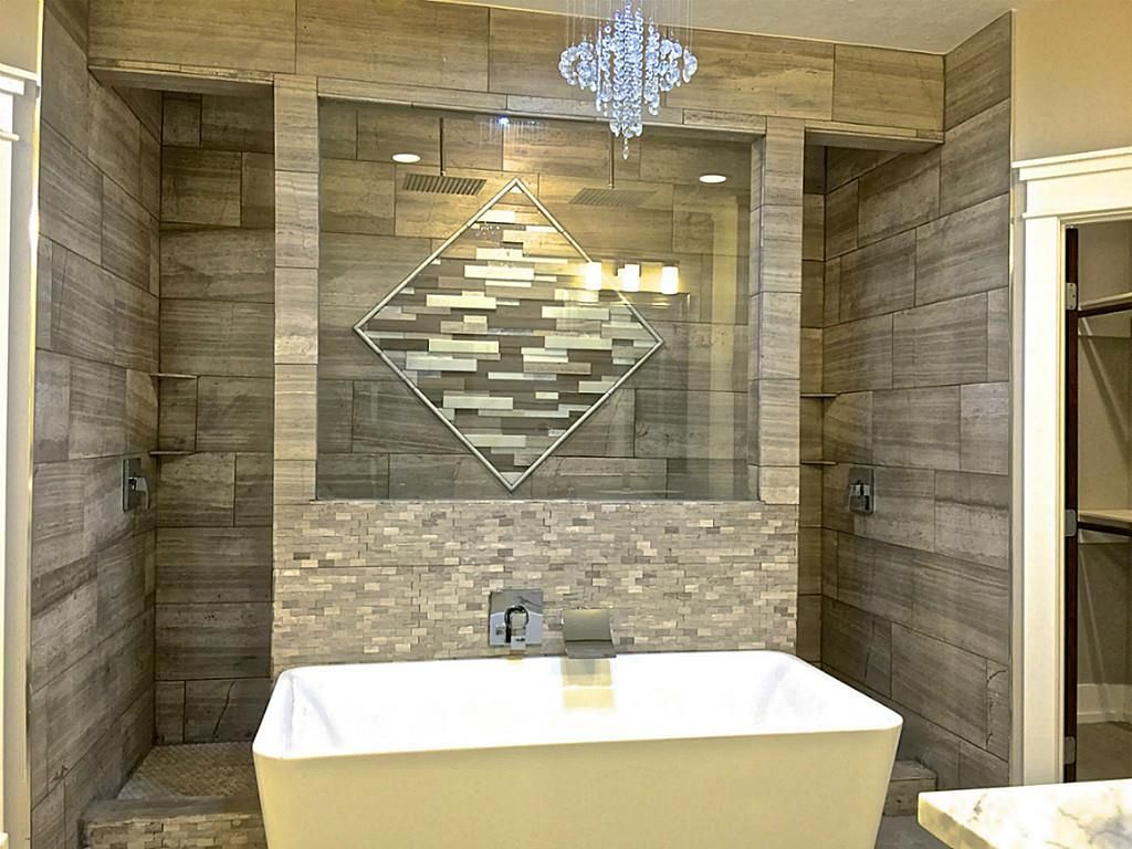 Walk behind, open shower with free standing tub. Perfect centerpiece for a  modern bathroom