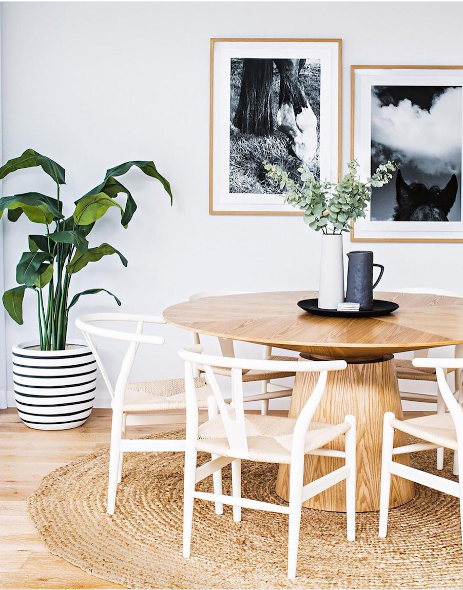 A earthy dining room with framed photography