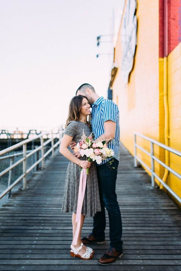We love this couple's idea to take their engagement photos at Coney Island! | Image by Lindsay Hackney Photography