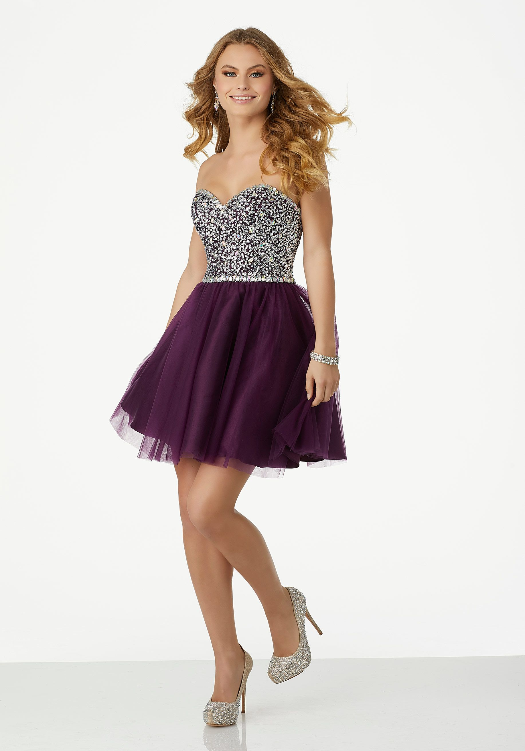 Soft tull prom dress with embroidered halter bodice and illusion