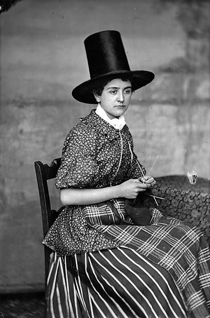 woman in national dress and knitting (Griffiths) | Peoples Collection Wales