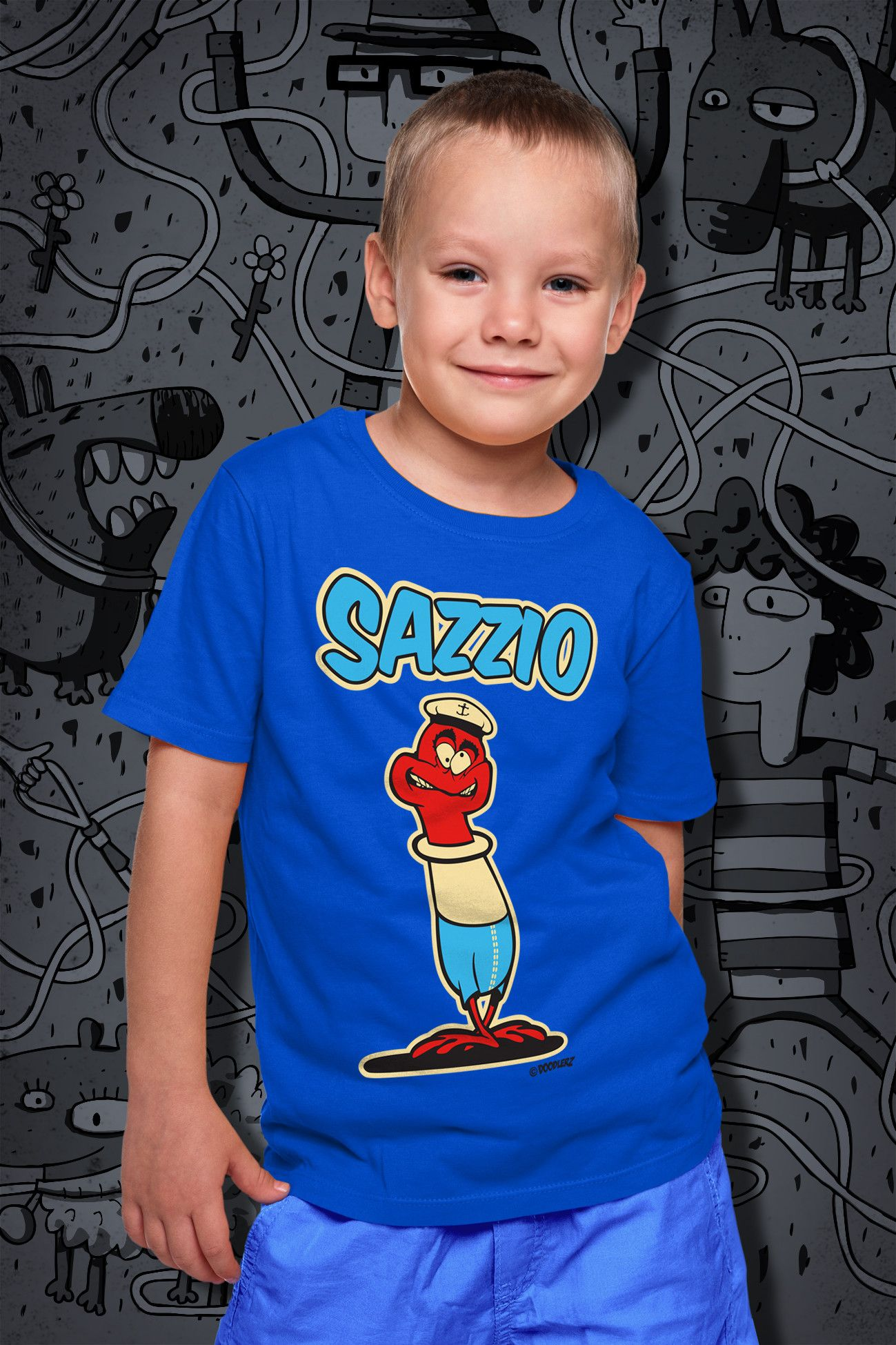 SAZZIO Short Sleeve Boys T-shirt. Filled with retro style and vintage appeal, this classic T-shirt from the Doodlerz collection is the perfect choice for your little sailor boy. Crafted in soft pure cotton with a round neckline, it comes designed with a full colour high quality print of our friend Sazzio.