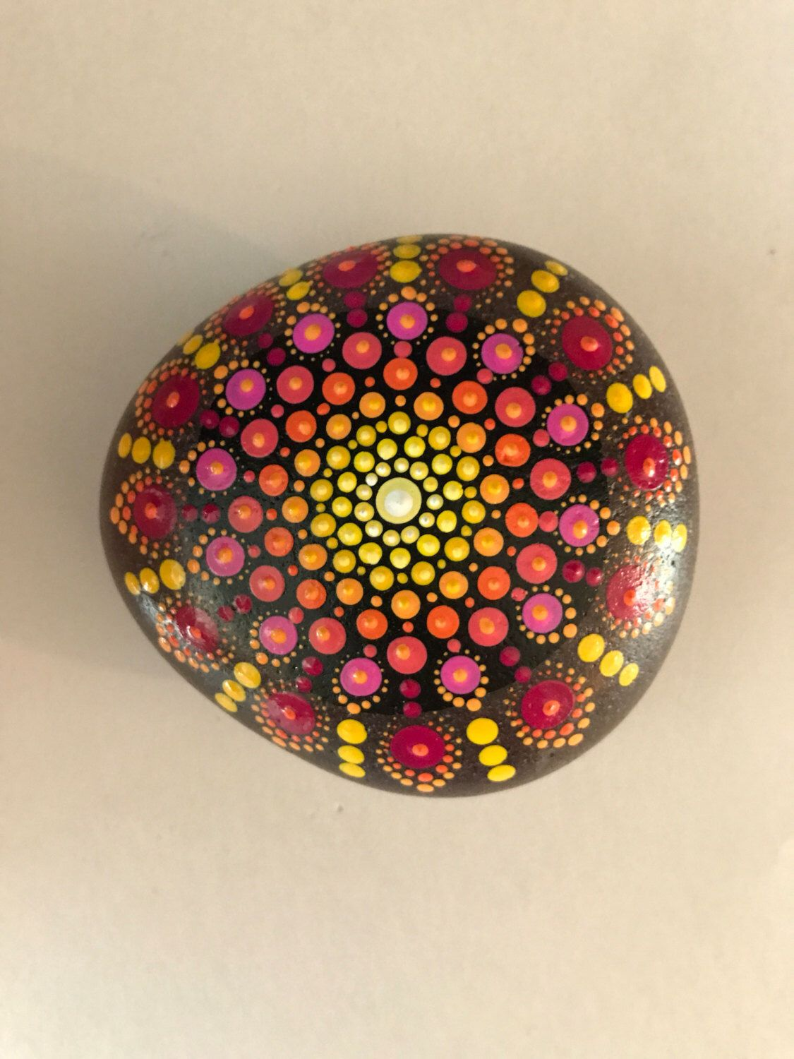 A personal favorite from my Etsy shop https://www.etsy.com/listing/497024001/mandala-stone-hand-painted-rock-dot