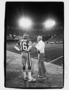 6cd712c104e Bill Walsh talks to Joe Montana during the game against the Dallas Cowboys  at Candlestick Park on December 19, 1983. The Niners defeated the Cowboys  42-17.