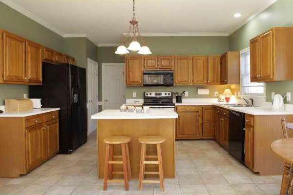 Designer Kitchen With Oak Cabinets And Black Granite
