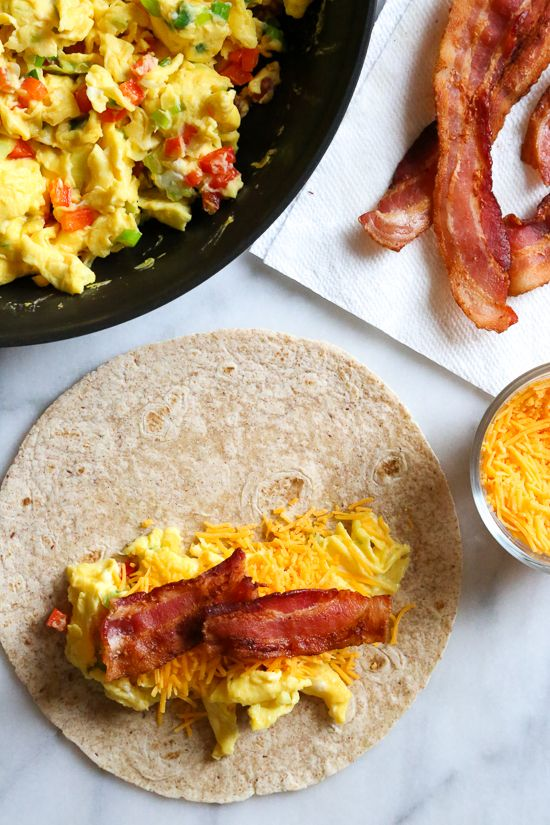 these freezer breakfast burritos  stuffed with scrambled eggs  scallions  bell pepper  bacon and