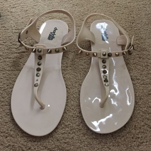 Studded sandals In great condition. Only flaw is a stud fell off which is shown in the picture. It is the hard jelly material and the straps are adjustable around the ankles. Please make offers Charlotte Russe Shoes Sandals