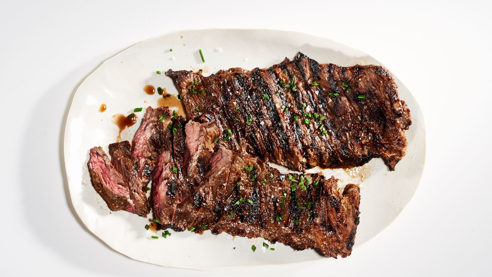 Sweet Onion–Marinated Skirt Steak #marinadeforskirtsteak The white vinegar's acidity curbs the onion's bite and highlights its sweetness, resulting in the perfect marinade. #marinadeforskirtsteak