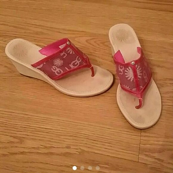 UGG Sandal Wedges! In great condition, still a ton of life left in these. Tan soles with a pink strap. Ugg logo printed on the straps and the soles. Super cute and a great deal! UGG Shoes Sandals