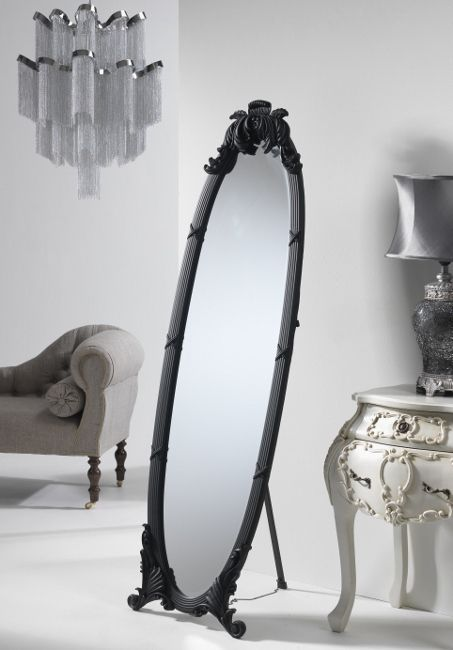 A beautiful antique black dress mirror with ornate frame This free ...