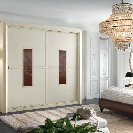 Bedroom beige stained wooden wardrobe design come with traditional style with floral pattern door wardrobe