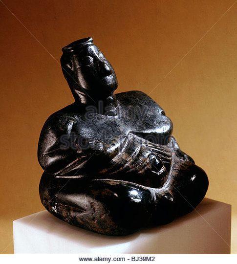 Neolithic stone sitting mother goddess/fertility figure, Anatolia, c6th millennium BC. Artist: Werner Forman - Stock Image