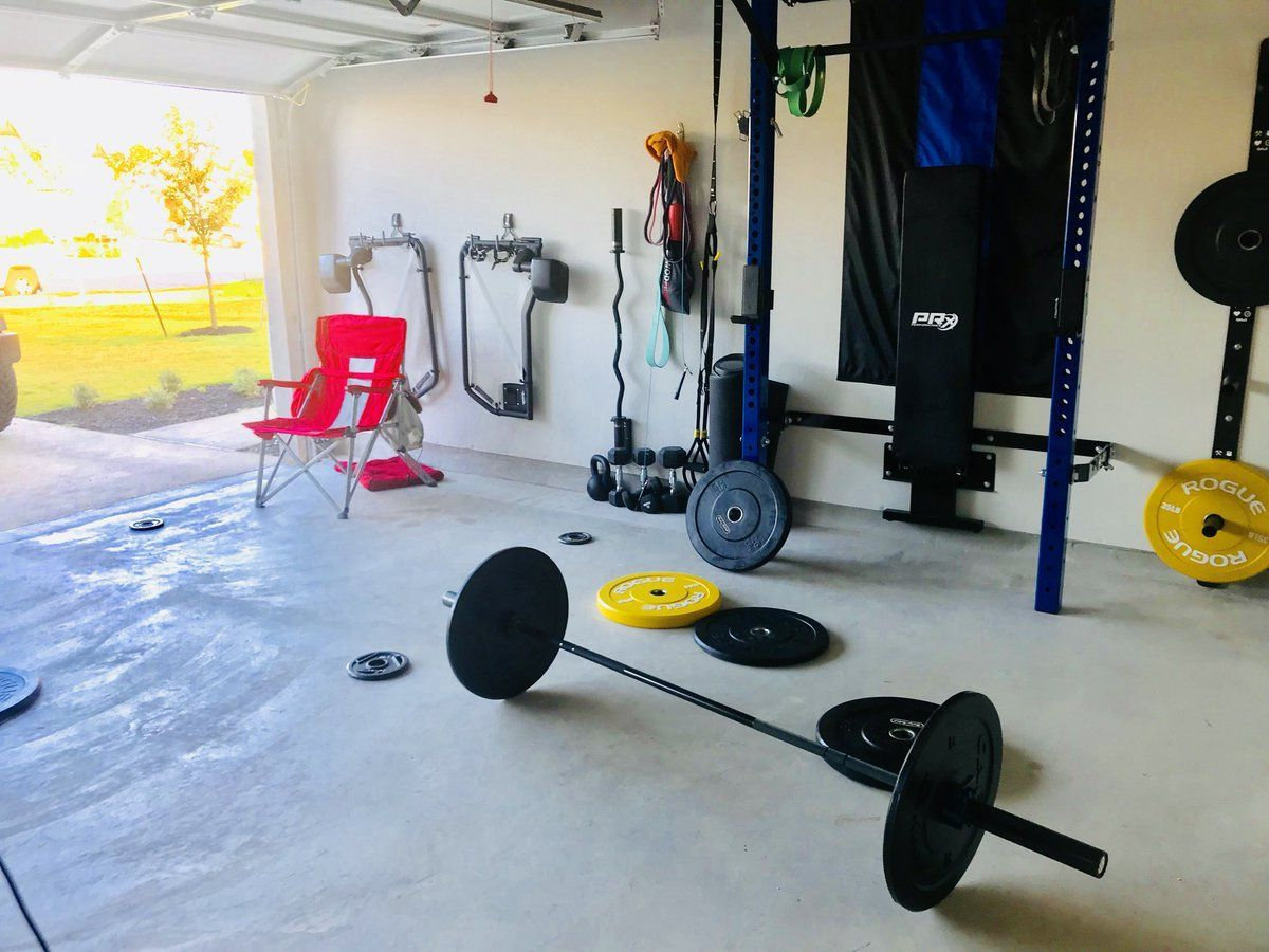 Sunny days call for home gym workouts with the garage door open