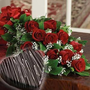 It contains a hearty Chocolate cake 2 kgs and 12 red roses bouquet with fillers. http://www.pickupflowers.com/send-love-and-romance-flowers-to-usa