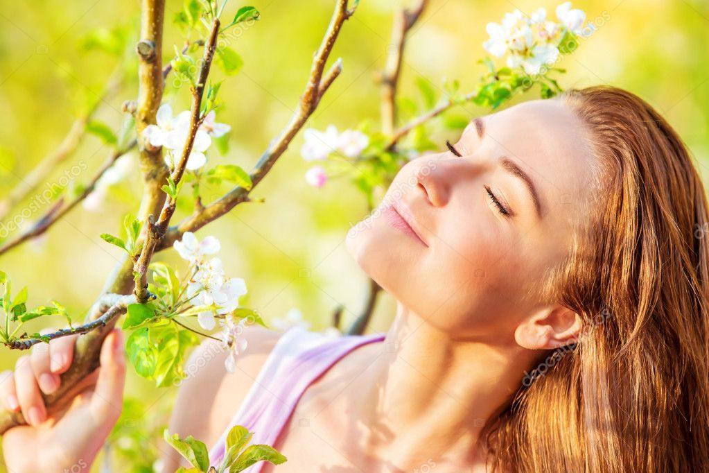 Calm woman enjoying nature stock photo sponsored