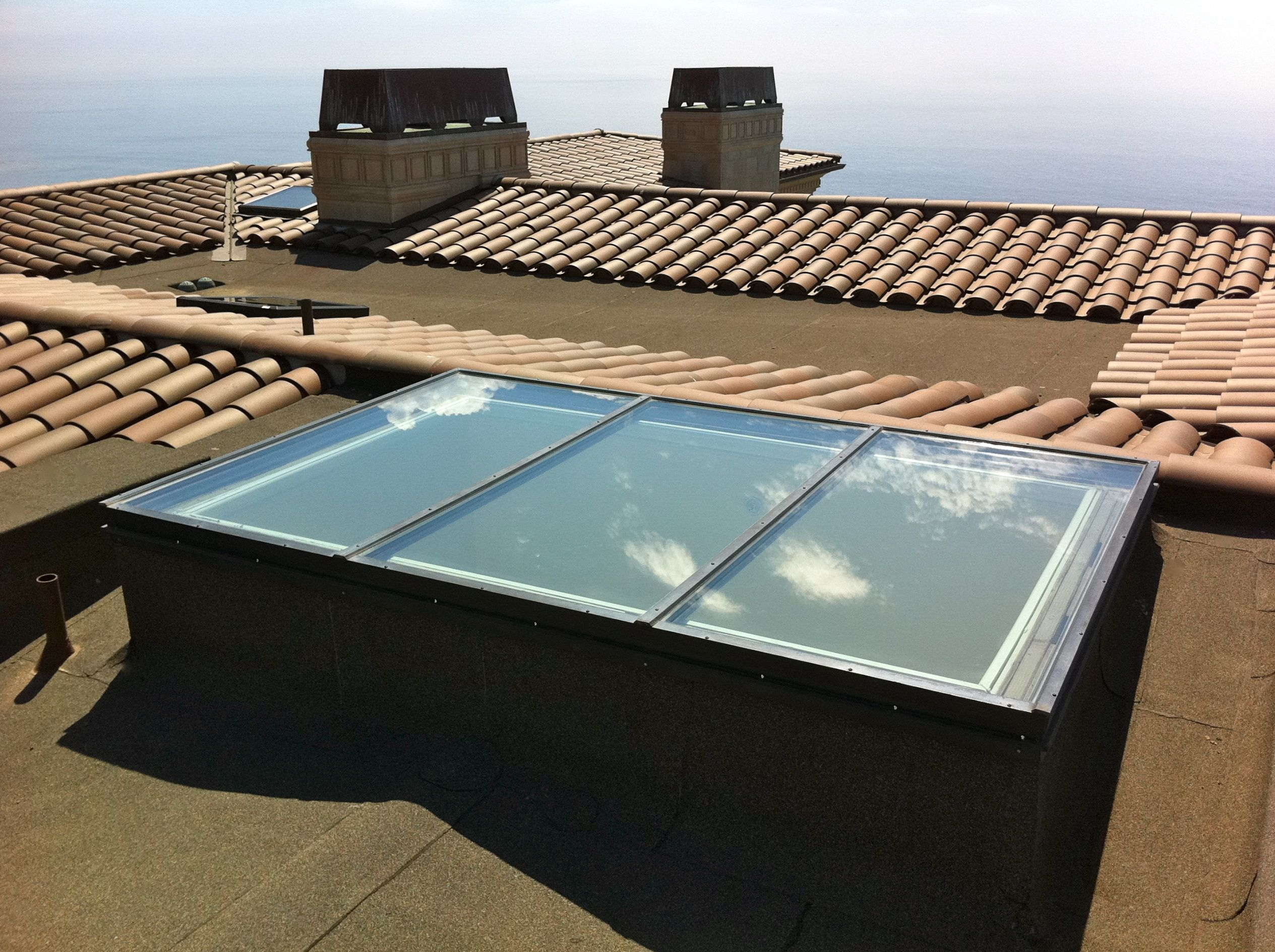 Www Chandlersroofing Com Curb Mounted Flat Low E Glass Skylight Installed With Modified Torch Down Roofing In Rancho Palos Verdes Ca